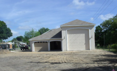 Home being built with rv garage turning heads on the for Custom rv garages