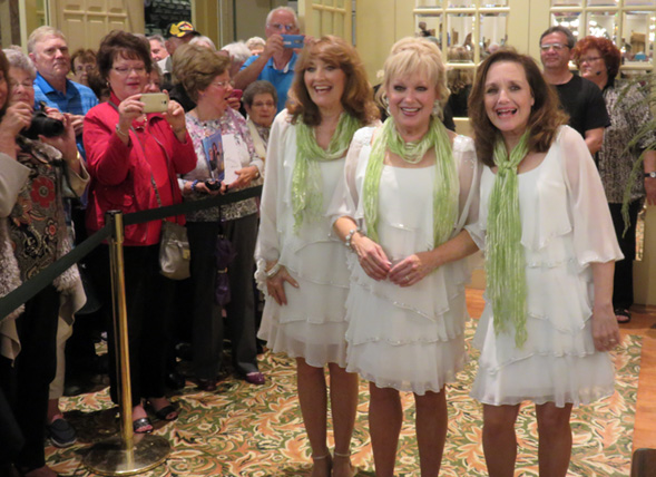 A bustling crowd of fans turned up in the Savannah Center lobby to snap pictures of the Lennon Sisters from left Kathy, Janet and Mimi.