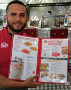 George Suleiman shows new menu for Johnny Rockets in The Villages. The restaurant at Lake Sumter Landing will test the new menu for the national restaurant called chain.