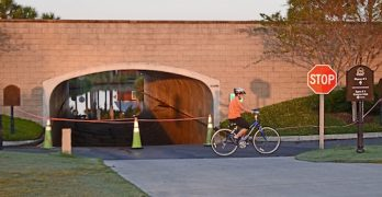 Early morning bike rider passes flooded tunnel in The Villages