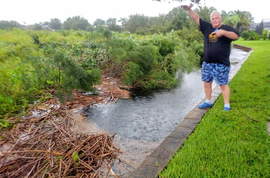 """David and Sandi Vanderwall said their back conservation area filled with water up to the top of the block wall. """"We live in Lynnhaven. We would have flooded if it had reached another half foot!"""" Sandi told Villages-News.com."""